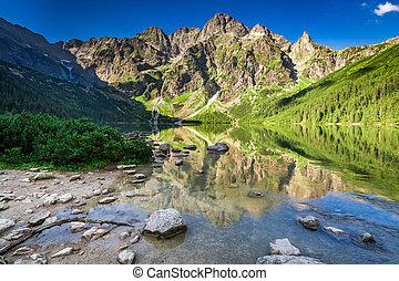 Beautiful sunrise at lake in the Tatra Mountains in Poland