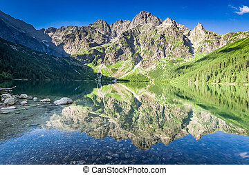 Beautiful sunrise at lake in the Tatra Mountains, Poland, Europe