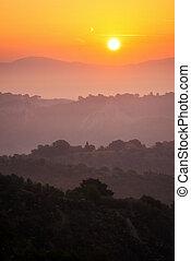 Beautiful sunrise at mountain landscape in summer.