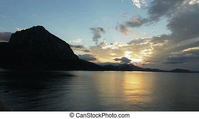 Beautiful sunrise in the Blue Bay near village Novyi Svit....