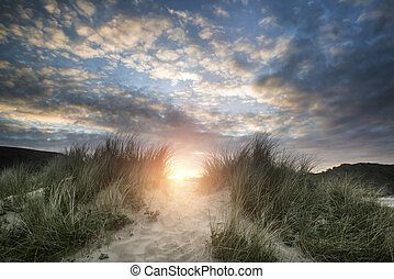 Beautiful sunrise landscape over Three Cliffs Bay on the Gower Peninsula in Wales