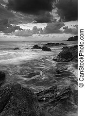 Beautiful sunrise landscape seascape over rocky coastline in...