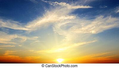 Beautiful sunrise on blue sky