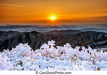 Beautiful sunrise on Deogyusan mountains covered with snow in winter, South Korea.