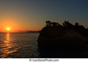 Beautiful sunrise on the beach in Corfu