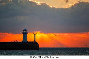 Beautiful sunrise over a beacon in Yalta, the Crimea