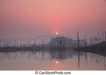 Beautiful sunrise over a lake.