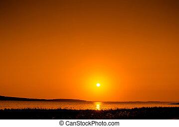 Beautiful sunrise over a lake