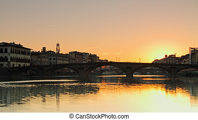 beautiful sunrise over Arno river in old town of Florence