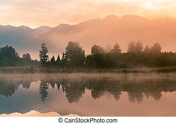 Beautiful sunrise over Matheson water lake