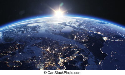 Beautiful Sunrise over the Earth. View from Space Satellite. Cities at Night. Changing from Night to Day 3d Animation Rising Shining Sun. Modern Business and Technology Concept. 4k Ultra HD 3840x2160.