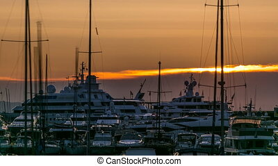 Beautiful sunrise over the harbor in Monaco timelapse....