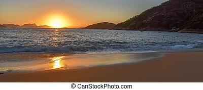 Beautiful sunrise, solar path on water and sand at the...