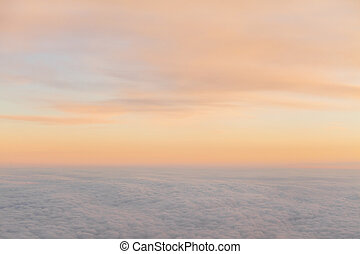 beautiful sunset above the clouds from aircraft