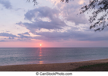 Beautiful sunset above the sea at Mai khao beach, Phuket,...