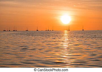Beautiful sunset above the sea beach.