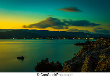 Beautiful sunset above the sea on island in green colours