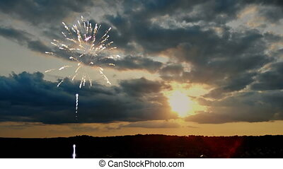 Beautiful sunset and colorful highlights fireworks after...