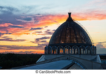 Beautiful sunset and dome of the pavilion Space  on VDNH, Moscow