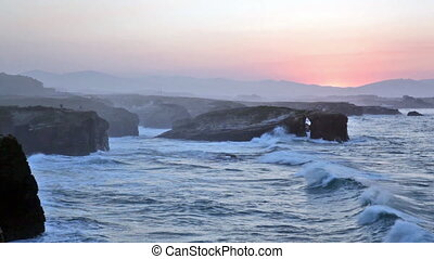 Beautiful sunset and stone arches on Playa de las Catedrales...