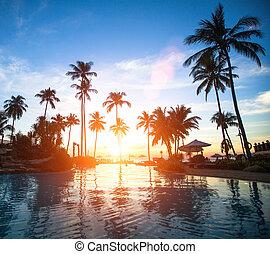 Beautiful sunset at a beach resort in the tropics.