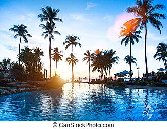 Beautiful sunset at a beach resort in tropics.