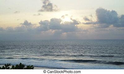 Beautiful sunset at beach, light beam shining through...
