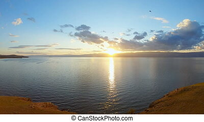 Beautiful sunset at lake. Aerial view of seascape