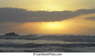 Beautiful sunset at the beach, amazing colors, light beam...