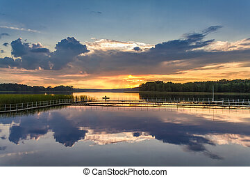 Beautiful sunset at the lake in summer, Poland