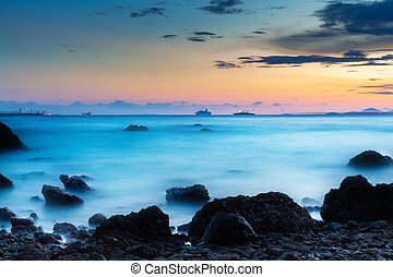 beautiful sunset at the seaside with rocks
