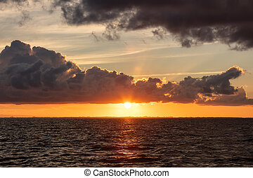Beautiful sunset by the coast of Belize