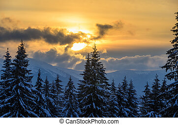 Beautiful sunset high in the winter mountains.