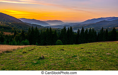 beautiful sunset in Carpathian mountains. view in to the...