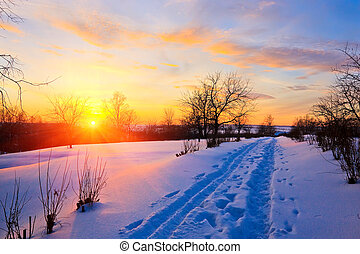Beautiful sunset in countryside at winter