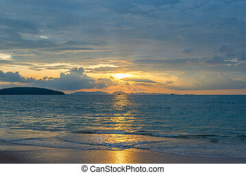 beautiful sunset in Krabi Thailand - sunset in orange colors over the Andaman Sea
