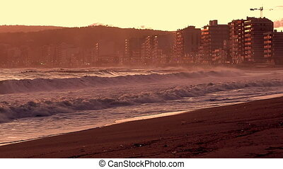 Beautiful sunset in Spain with big waves, Costa Brava