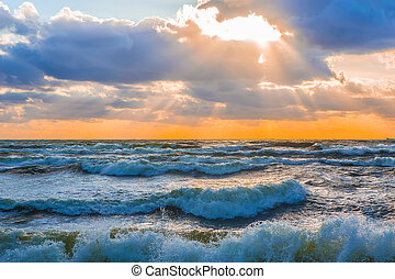 sunset in the cloudy sky over the stormy sea - Beautiful...