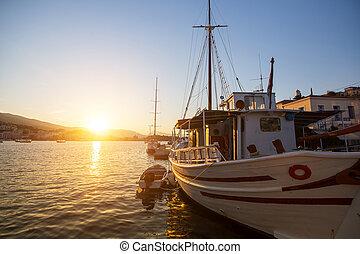 Beautiful sunset in the Marina of Greek Island in Saronic Gulf.