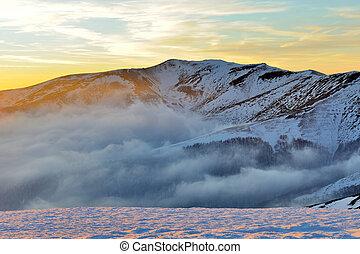 Beautiful sunset in winter mountain