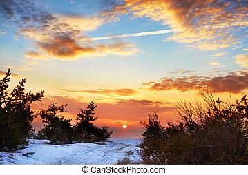 Beautiful sunset in winter mountains