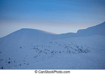 Beautiful Sunset in Winter Mountains.