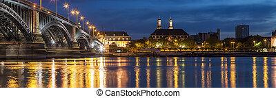 Beautiful sunset night over Rhine / Rhein river and old bridge in Mainz near Frankfurt am Main, Germany.