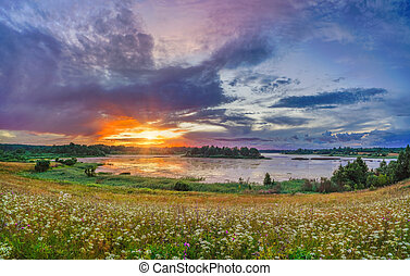 Beautiful sunset on a lake in countryside