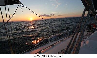 Beautiful sunset on a yacht sailing