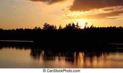 Beautiful sunset on forest lake