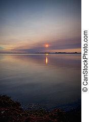 Beautiful sunset on lake erie beach in southwestern Ontario, Canada
