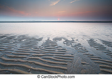 beautiful sunset on north sea at low tide