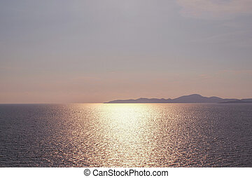 Beautiful sunset on sea scape. Pastel tone background.