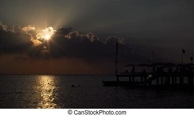 beautiful sunset on sea. silhouette of the pier in Mediterranean sea